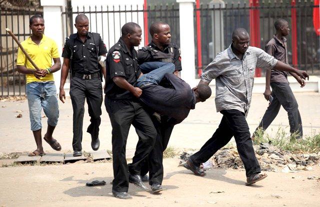 Policemen manhandling a citizen
