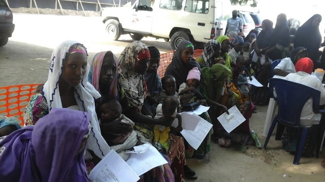 Displaced women queue for food at an MSF facility