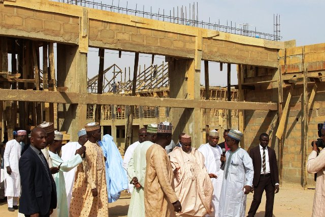 Governor Aminu Tambuwal inspecting ongoing works at the new Government Secondary School under construction