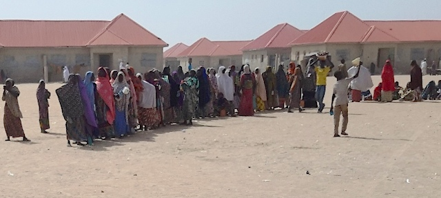 Women and children queue for food at the Bakassi IDP camp