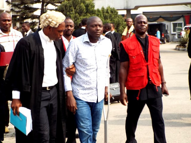 Former NIMASA DG, Patrick Akpobolokemi (middle) is accused of money laundering