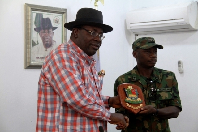 Governor of Bayelsa State, Seriake Dickson, in a handshake with the Commander of Operation Delta Safe, Apochi Suleiman