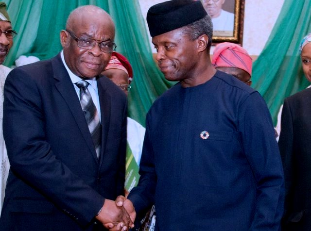 Acting President Yemi Osinbajo congratulating CJN Walter Onnoghen shortly after the latter was sworn in