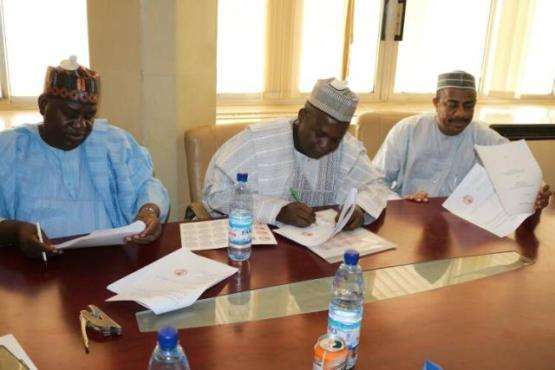 L-R: Chairman of IML Industries Ltd, Bilya Sanda, Sokoto State  Attorney General and Commissioner of Justice, Sulaiman Usman, and the SSG, Bashir Garba, during the signing of the MoU