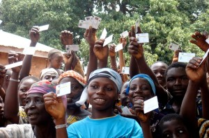 Beneficiaries show their health insurance cards in Kwara State, Nigeria. Photo credit: WHO Bulletin/Pharmaccess