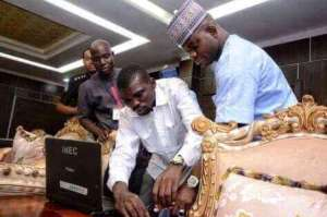 Kogi STate Governor, Yahaya Bello, being registered by an INEC official in his office in Lokoja. Photo Credit: Kogireports