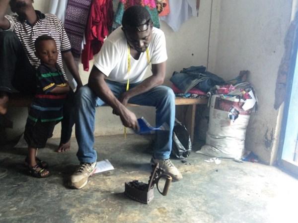 Omoyeni struggling to light up charcoal iron