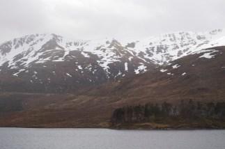 Snow. Hills. Loch. House.