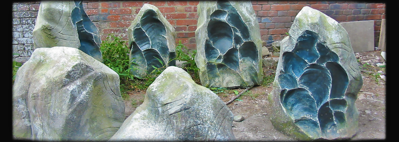 artificial standing stones, fake concrete prop, faux rock stone poly scenic artist rust faux rubble, realistic pretend stone slabs, poly concrete props, hand painted scenic art artist, movie prop dystopian armageddon film tv marketing props, lightweight theatrical painting imitation artificial rocks
