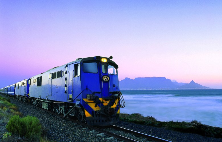 the blue train luxury train travel at sunset