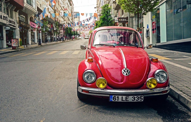 Red Volkswagen Beetle Parked at Road Side Near Pedestrian Lane