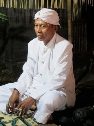 The dalang rests after a long performance. When he was young he would perform up to five or six times a night, returning home at dawn. Now he will only do two shows a day. When he is ready to retire, one of his sons will take his place.