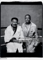 First friends, then fierce rivals in the ring, Ali and Joe Frazier pose for a portrait in the boxing robes they wore the night of their first bout, at Frazier's Gym in 2003. (Walter Iooss Jr/Sports Illustrated)