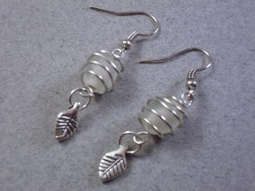 Oval frosted cage drop earrings with leafs