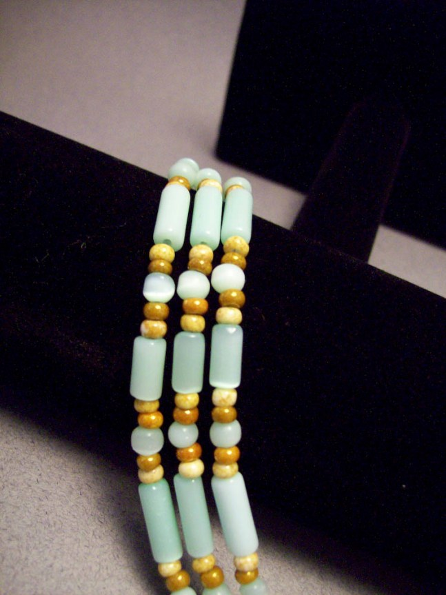 Three strand green cat eye bracelet