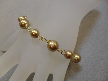 Wire wrapped spiral pearl bracelet