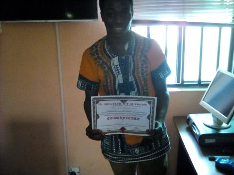 Akin displaying his Certificate after SPSS Training