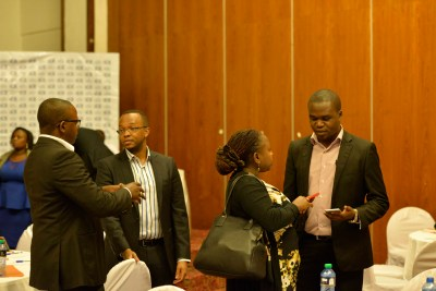 Guests networking after the forum