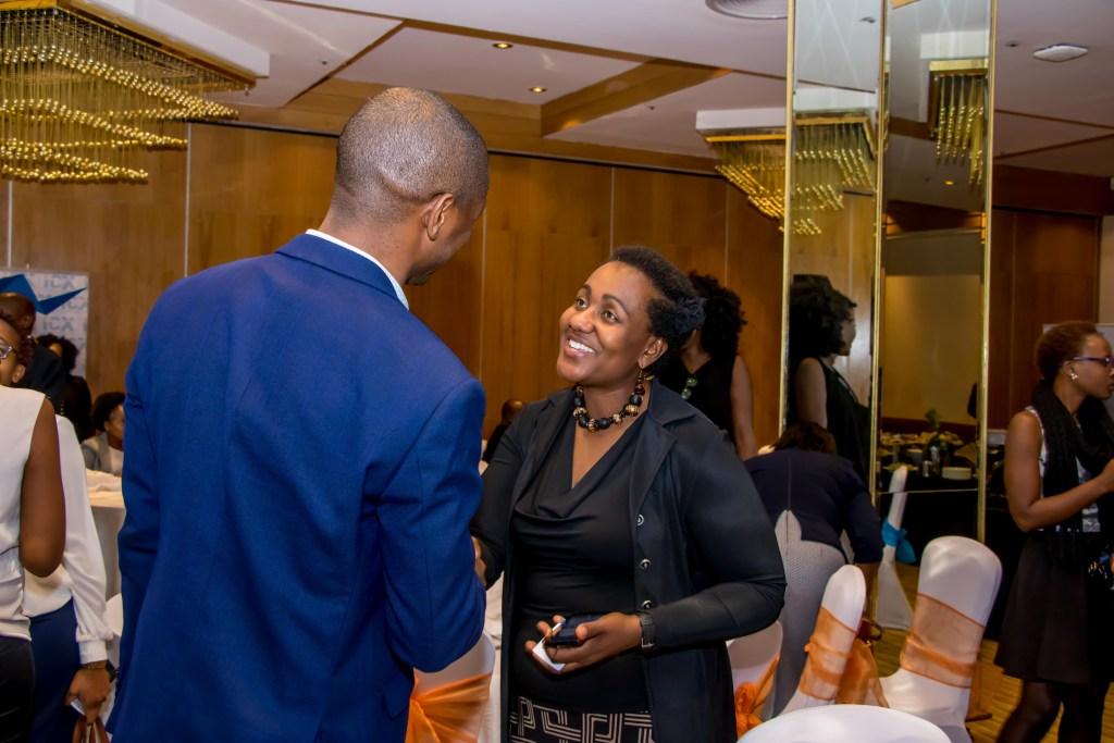 Carolyne Gathuru an ICX Kenya Board member networking with members.