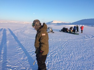 Working on the sea ice off Thule Air Base is a team effort that requires much co-ordination, learning, and communication which are more difficult to do at -33 C.