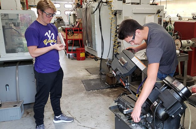 students working on band saw