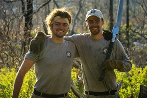 Two male AmeriCorps fire management team members