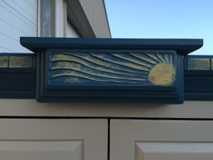 sun armoire - sun carving