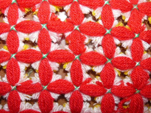 un cadre pour tapis pompons
