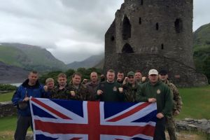 Members of Britain First pose in front of Dolbadarn Castle