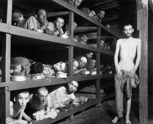 Buchenwald in 1945 after the Allies liberated it. Wiesel is in the second row from the bottom, seventh from the left, next to the bunk post
