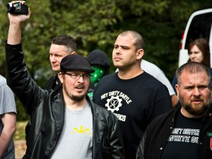 Matt Parrott of the Traditionalist Worker Party, (left. in black cap) and Brien James (right with beard) at the Leif Erickson Day event in Philadelphia, Oct. 2013. And yeah, we see the shirt behind them. Brien thought he would make a killing selling them.