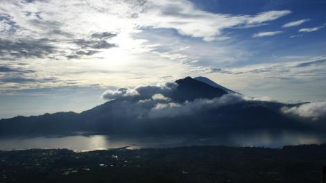 Sunrise appear from behind Mount Agung, the highest mountain in Bali
