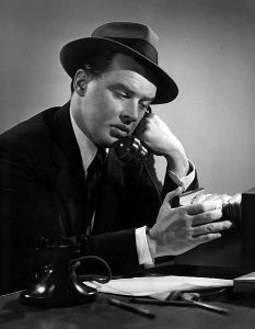 John McQuade as Charlie Wild from the program Charlie Wild, Private Detective.