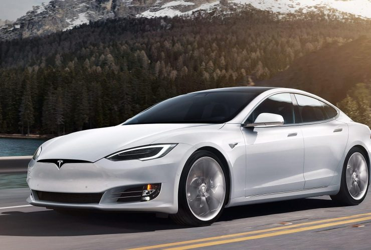 White 2020 Tesla Model S in front of mountains