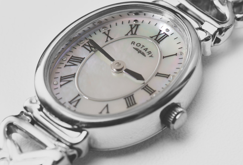 Close up image of a Rotary Watch featuring a mother of pearl face