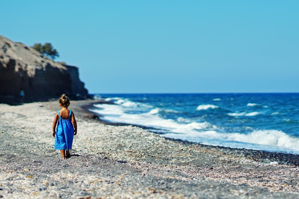 Best Greek Girl Names (With Meanings) For Your Little Goddess, Greek girl on beach in Greece