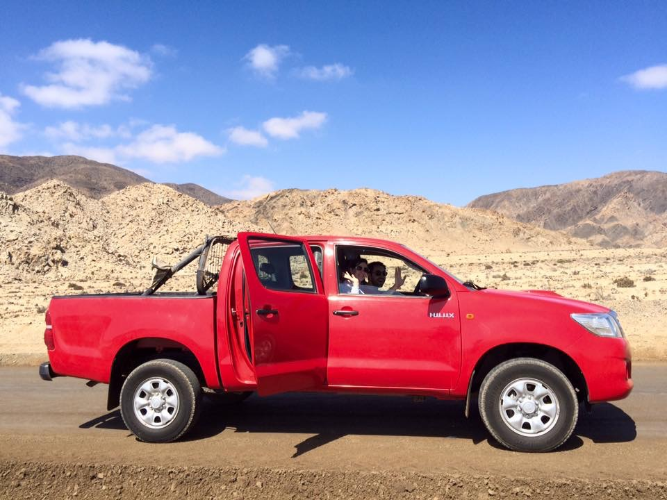 Red truck in the Atacama Desert near Caldera, Chile