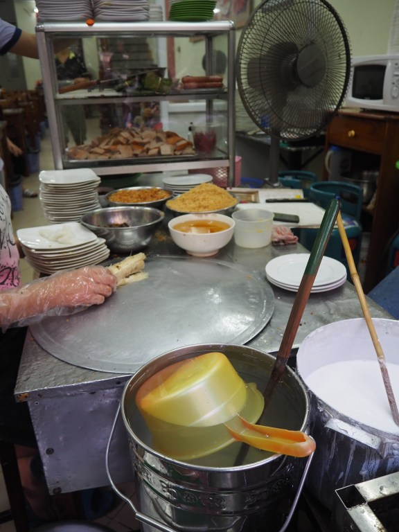 Food being prepared at a street stall in Hanoi
