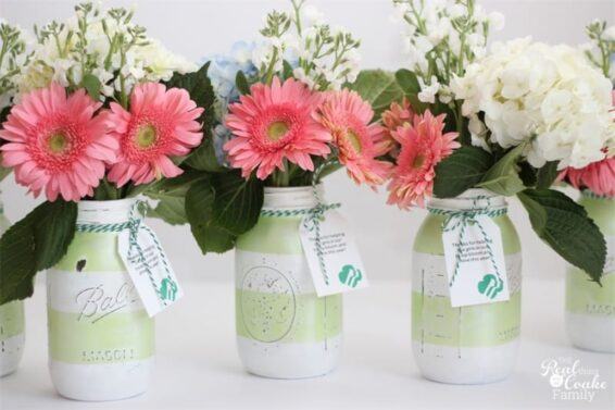 Painted mason jar vases with flowers