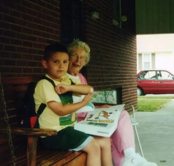 My grandmother sitting on a porch swing with my son.