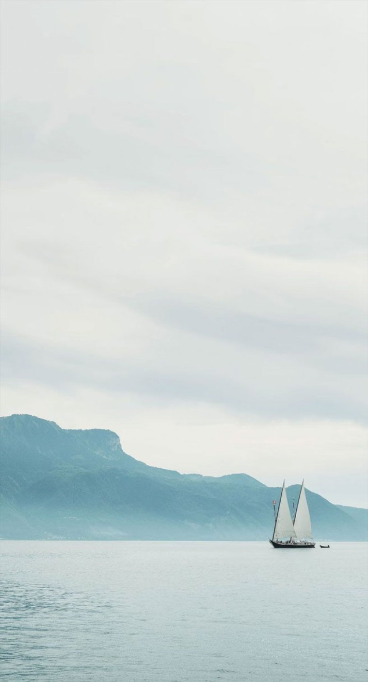 Sailing boat mountain iPhone wallpaper