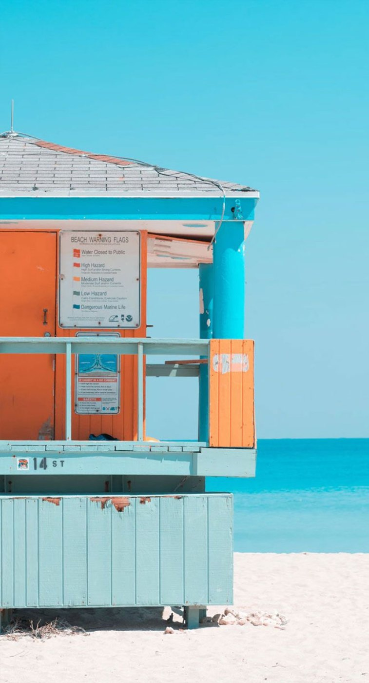 Blue sky + orange beach hut & white sand iPhone wallpapers
