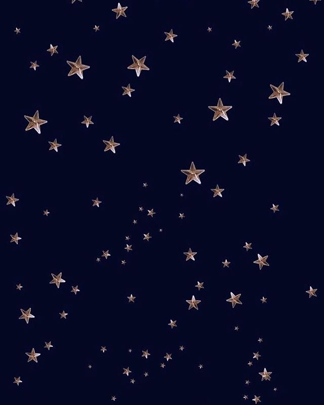 Gold stars on dark blue background