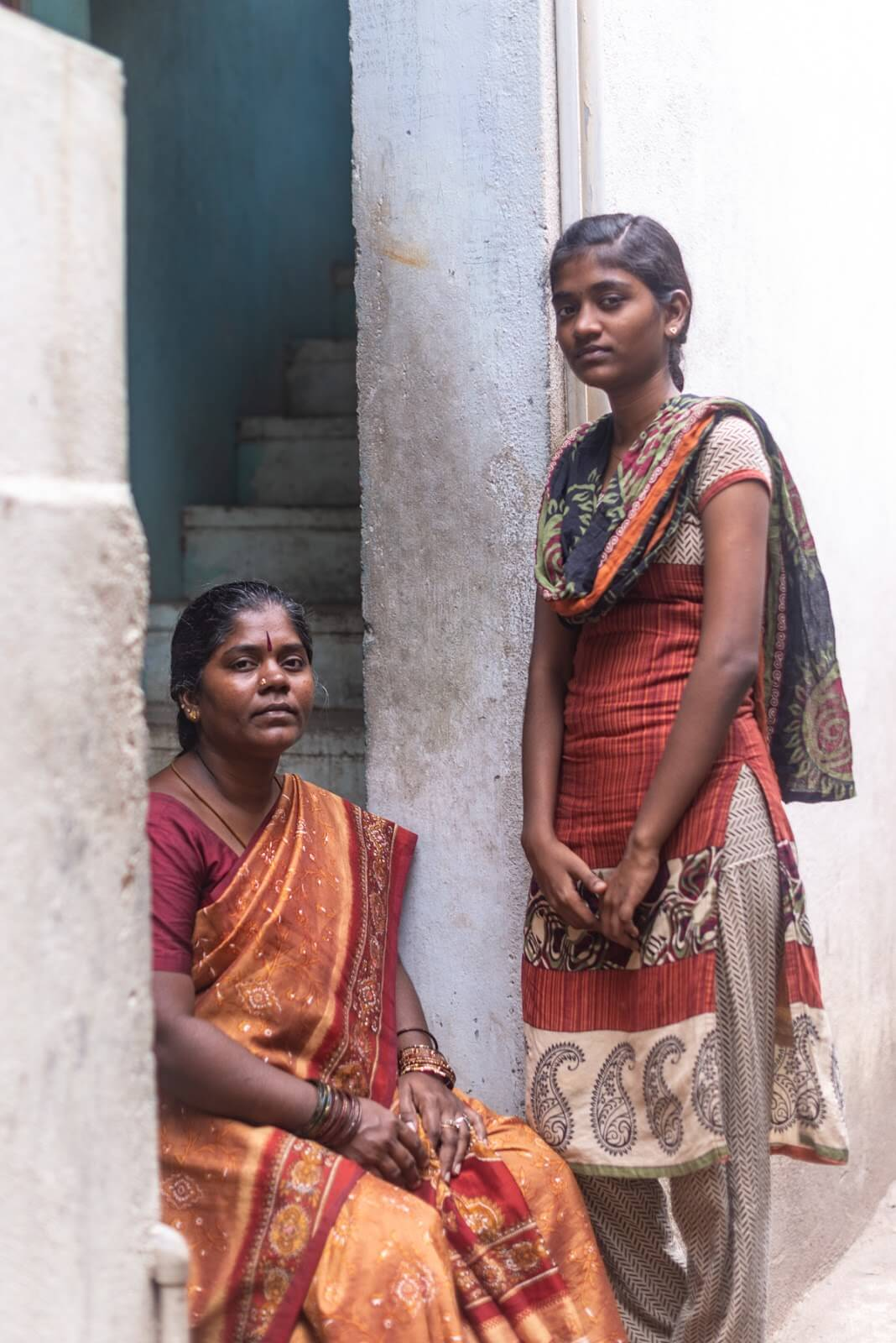Kannika and one of her daughters outside their home in Chennai, India. Photo credit: Gayatri Nair