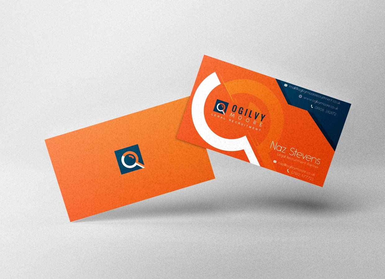 Two Oglivy-Moore business cards on top of each other
