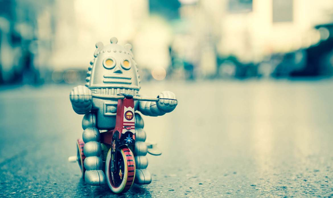 Robot doll on a bike
