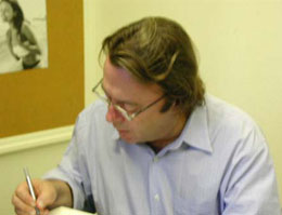 Hitchens signing book