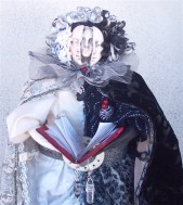 """2008 art doll depicting """"Life: The Black, The White, & The Grey"""" using antique and vintage fabrics, trims. This is in a private collection."""