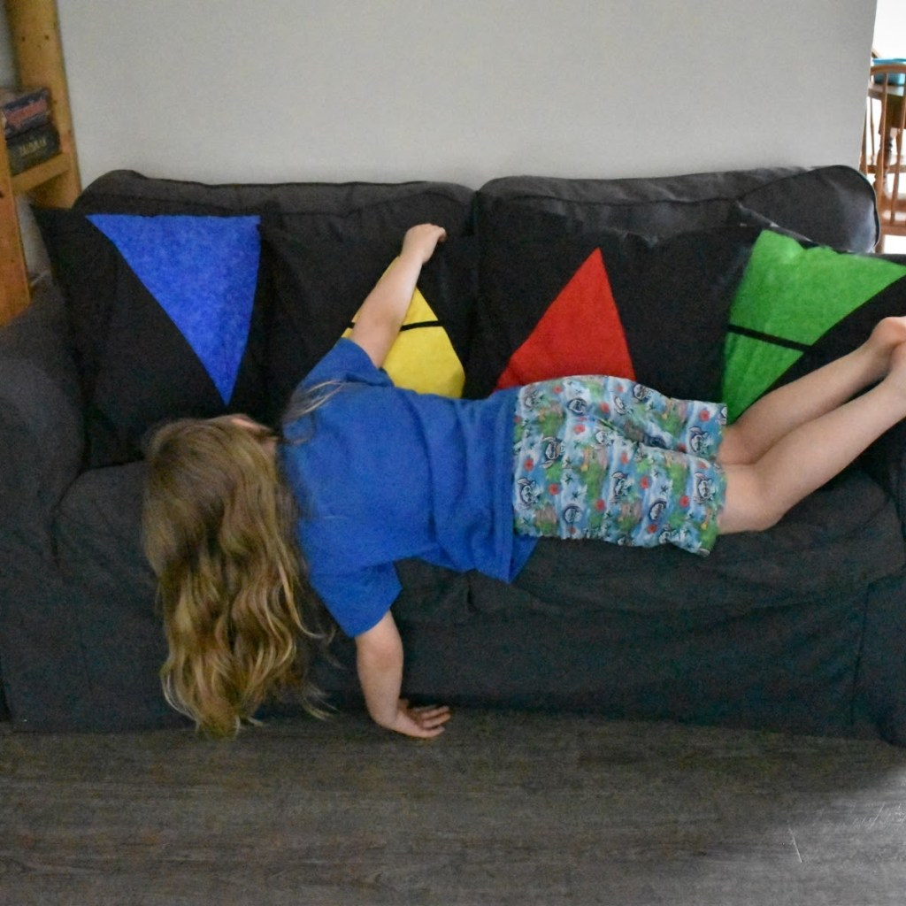 My son showing how best to use the elemental throw pillows.
