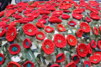 Photo No. 5 of 12 - Anzac Day March at Federation Square, Melbourne, Australia featuring Australia's first own car – its hood here blanketed with a sheath of poppies photo taken by Karen Robinson 25.4.2015.JPG